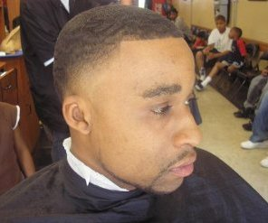 A black man with a low fade haircut
