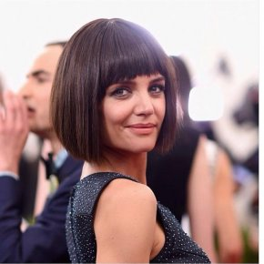 classic short brunette blunt bob haircut with blunt bangs for women over 50